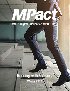 MPact winter 2017 cover photo of man running up stairs